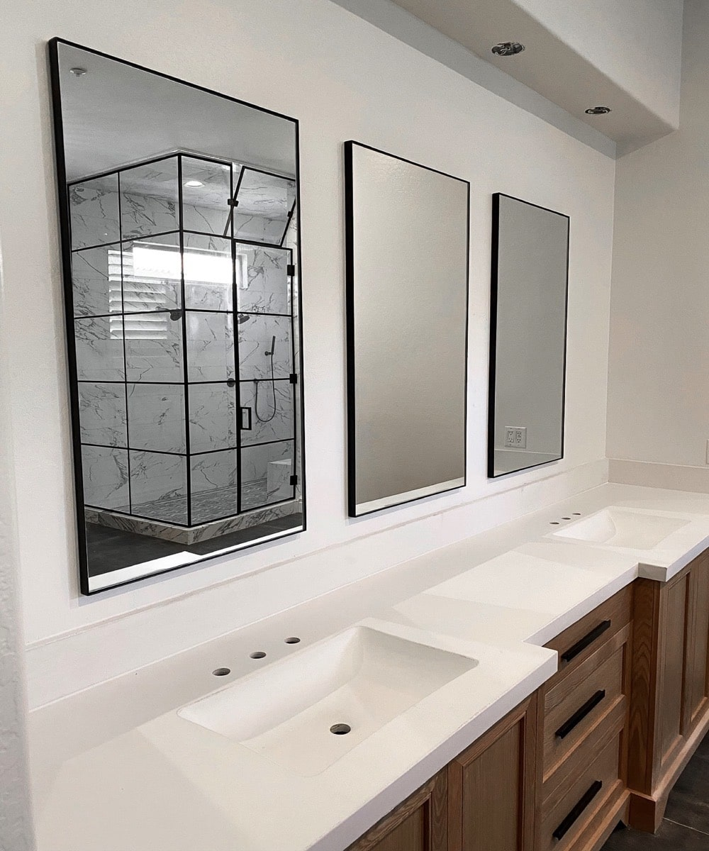 3 Glass Mirrors In A Bathroom